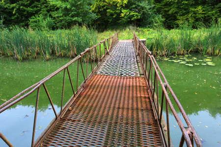 metall: Metall bridge over green river
