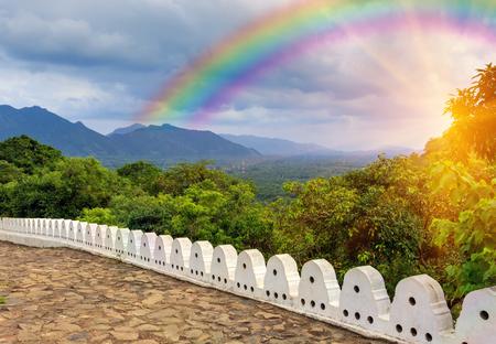 shri: viewpoint on rainbow over valley from Buddha Rock temple in Dambulla, Shri Lanka
