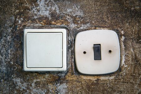switches: two abstract electric switches on wall