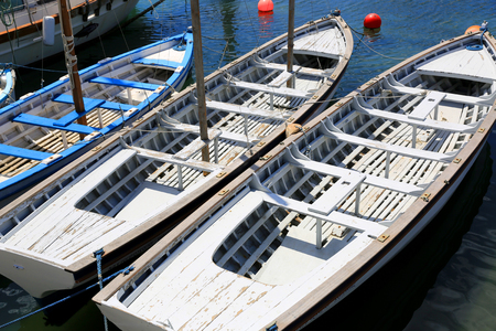 limpid: Wooden boats on sea moorage