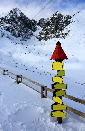 information point: information point and wooden fence in winter mountains
