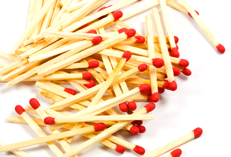 red heads: matches with red heads on white background Stock Photo