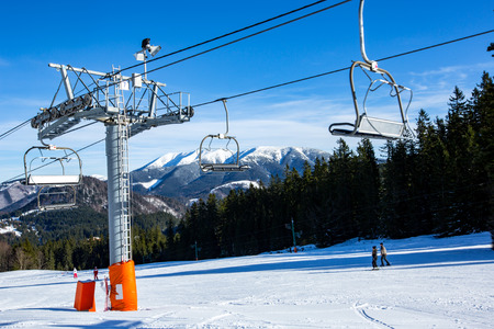 chair on the lift: ski chair lift on mountain resort in nice winter day Stock Photo