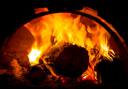 hot fire of burning logs in oven
