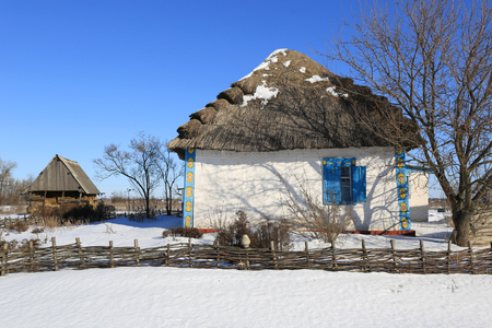 oldstyle: Traditional ukrainian old-style house with thatch roof  Stock Photo
