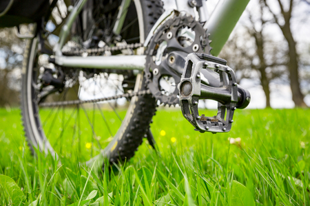 soft pedal: bike on spring meadow - wiev on pedal