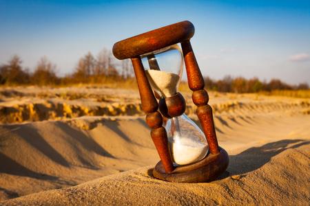 old hourglass on sand in desert Reklamní fotografie