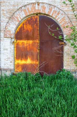 garage on house: Old steel door of the abandoned buildings Stock Photo