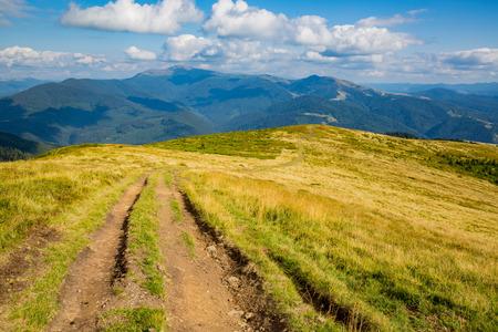 rut road on mountains slope. Ukraine, Carpathians Stock Photo