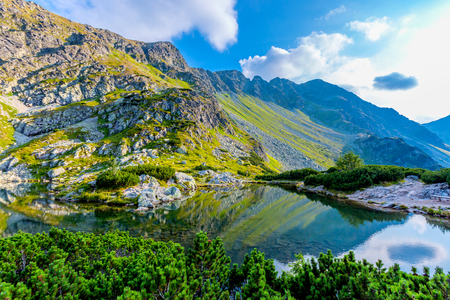 Majestic mountain landscape with lake in West Tatras, Slovakia Фото со стока
