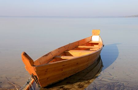 wooden boat on lake at morning time