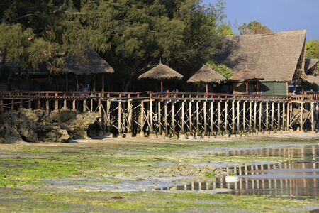 ocean shore at low tide in morning, view to Nungwi village, Zanzibar, Africa