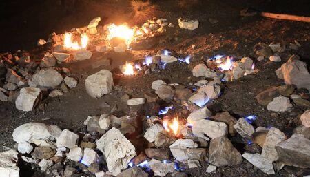 Night burning gass fire on the mountain Chimera. Famous Lician tourist way near Cirali in Turkey