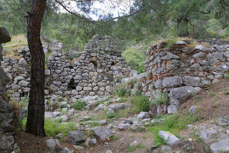 Chimera church  ruin  in forest near Yanartash near cirali village in Turkey. Famous Likya Yolu tourist way in Turkey Stock Photo