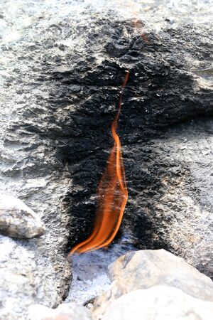 burning natural gass fire on the mountain Chimera. Famous Lician tourist way near Cirali in Turkey Stock Photo