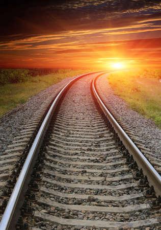 Scene with railway turn to sunset