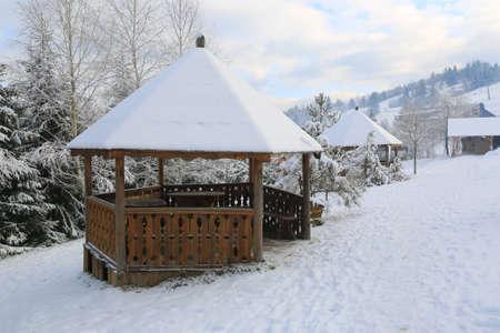 wooden gazebo in winter mountain park, Carpathian, Ukraine