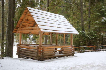 nice wooden gazebo in winter forest Standard-Bild