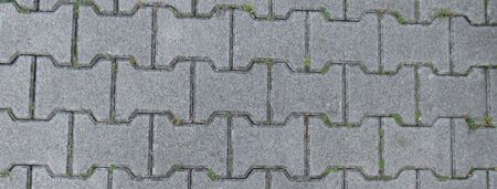 The image shows a texture of interlocking paving stones. Stock Photo