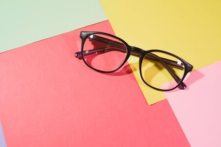 glasses on a colored background