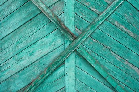 The texture of the boards. The fence is painted in green. Stok Fotoğraf - 147578617
