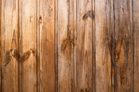 The texture of the boards. Brown painted fence.