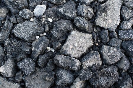 Pieces of asphalt pavement in the hole in the road 版權商用圖片