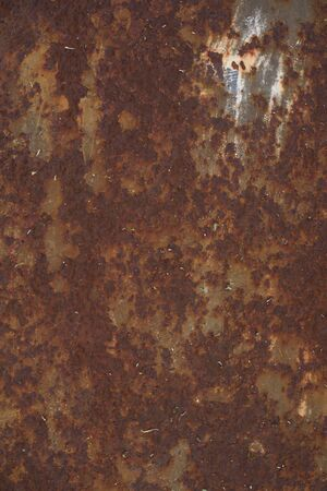 Strongly worn iron rusty wall from a large garage