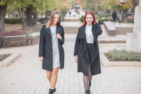 Two cute young girls are walking and talking about important topics