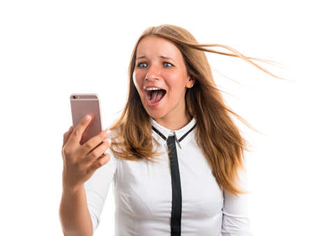 delight: Happy young woman exercising photographed using a mobile phone camera