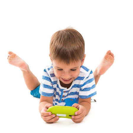 game console: Happy child playing a game console. Photo on a white background