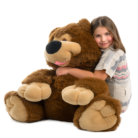 Portrait of a beautiful girl with great teddy bear on a white background Stock Photo