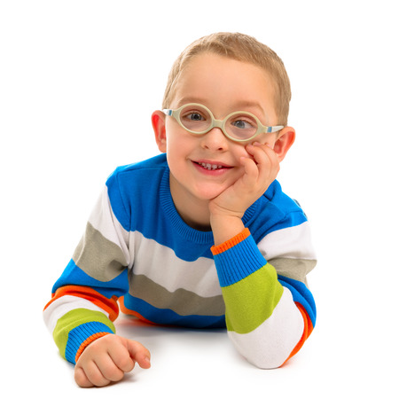 Portrait of cute smiling boy with glasses on a white background Imagens