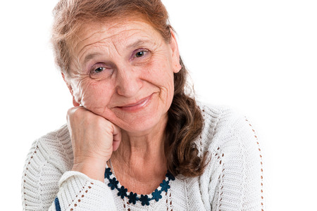 kindly: Portrait of a happy old woman on a white background