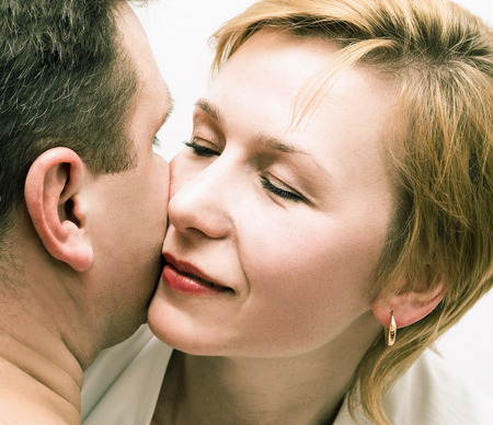 smooch: Man and woman. Love. Portrait of a loving heterosexual couple close-up Stock Photo