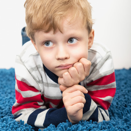 the weariness: Portrait of a cute little sad child Stock Photo
