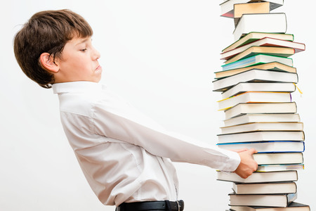 fallacy: Portrait of a boy with books Stock Photo