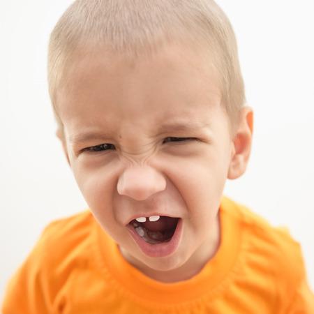 berserk: Portrait of a little angry boy close-up