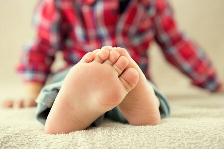 Childrens feet. Photo closeup