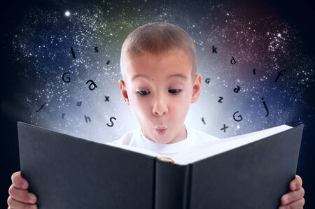 discovered: Child discovered the magical world of books Stock Photo