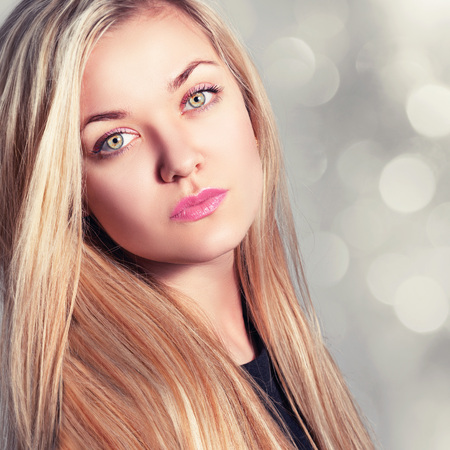 Fashion portrait of a beautiful young blonde woman