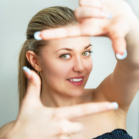 womans hand: Portrait of a beautiful young woman. Female face closeup