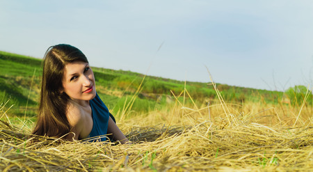 Beautiful young woman resting in the summer on the nature