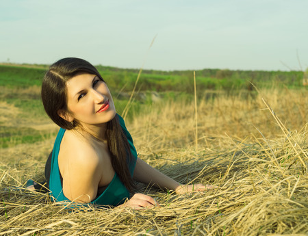 Portrait of a beautiful woman in the summer on the nature Stock Photo