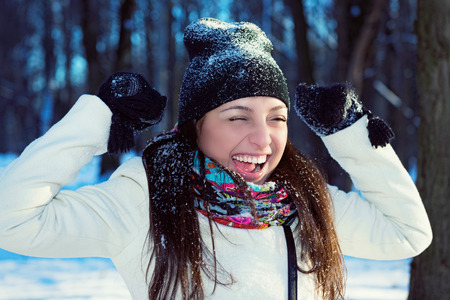 Portrait of a happy young woman in winter nature Stock Photo