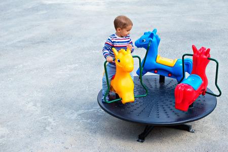 Happy child in the amusement park