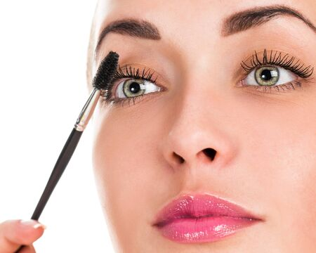 Eye makeup. Applying mascara on the lashes. Portrait of a woman close up