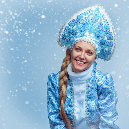 Snow Maiden. Winter portrait of a beautiful young smiling woman