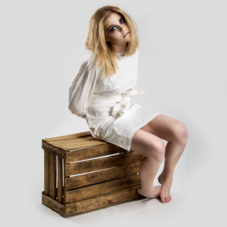 Portrait of a beautiful young woman in a straitjacket Stock Photo
