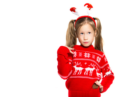 Portrait of a child in a Christmas costume. Photo on a white background 스톡 콘텐츠
